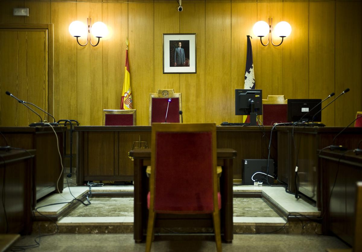 A portrait of King Juan Carlos of Spain hangs on the wall at the Palma de Mallorca courtroom, where The Duke of Palma, Inaki Urdangarin, will be questioned by a judge during the 'Palma Arena Trial', on February 24, 2012 in Palma de Mallorca, Spain.