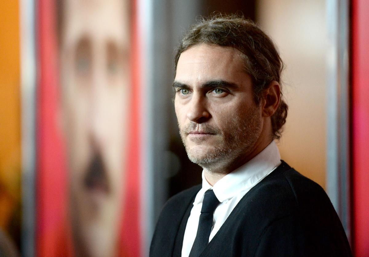Actor Joaquin Phoenix attends the premiere of Warner Bros. Pictures 'Her' at DGA Theater on December 12, 2013 in Los Angeles, California.