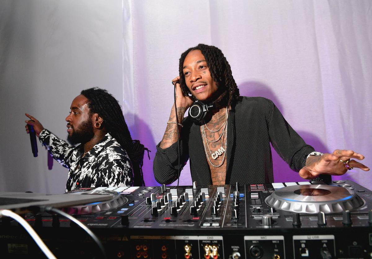 Wiz Khalifa (R) DJs during the 2018 Baby2Baby Gala Presented by Paul Mitchell at 3LABS on November 10, 2018 in Culver City, California.
