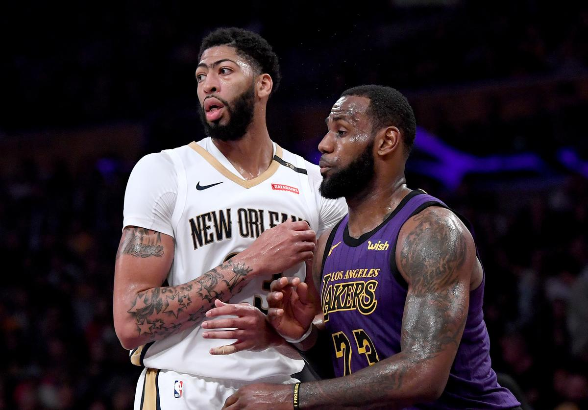 LeBron James #23 of the Los Angeles Lakers guards Anthony Davis #23 of the New Orleans Pelicans during a 112-104 Laker win at Staples Center on December 21, 2018 in Los Angeles, California. NOTE TO USER: User expressly acknowledges and agrees that, by downloading and or using this photograph, User is consenting to the terms and conditions of the Getty Images License Agreement.