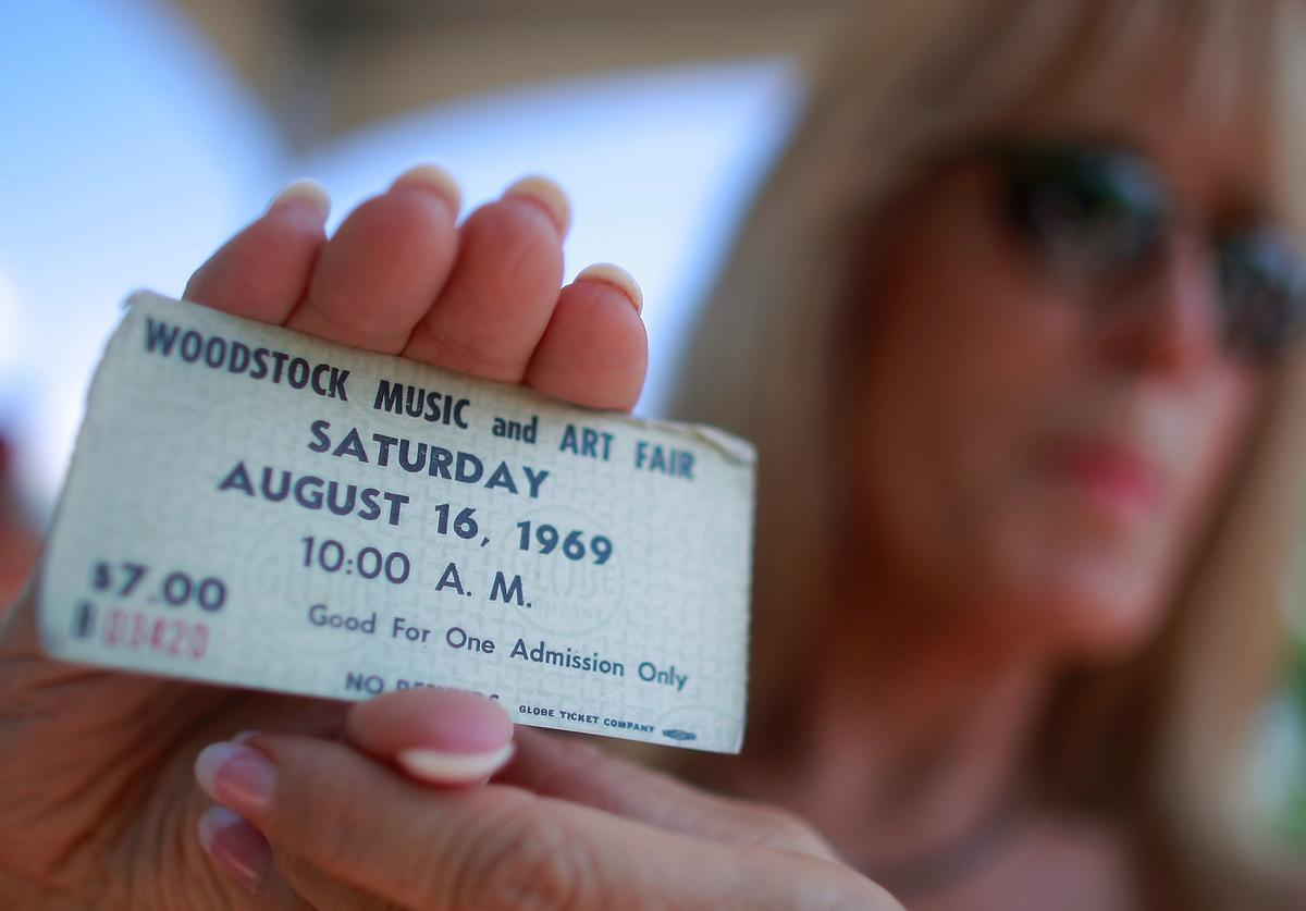 Janet Huey holds her original concert ticket as the 40th anniversary of the Woodstock music festival approaches August 14, 2009 in Bethel, New York