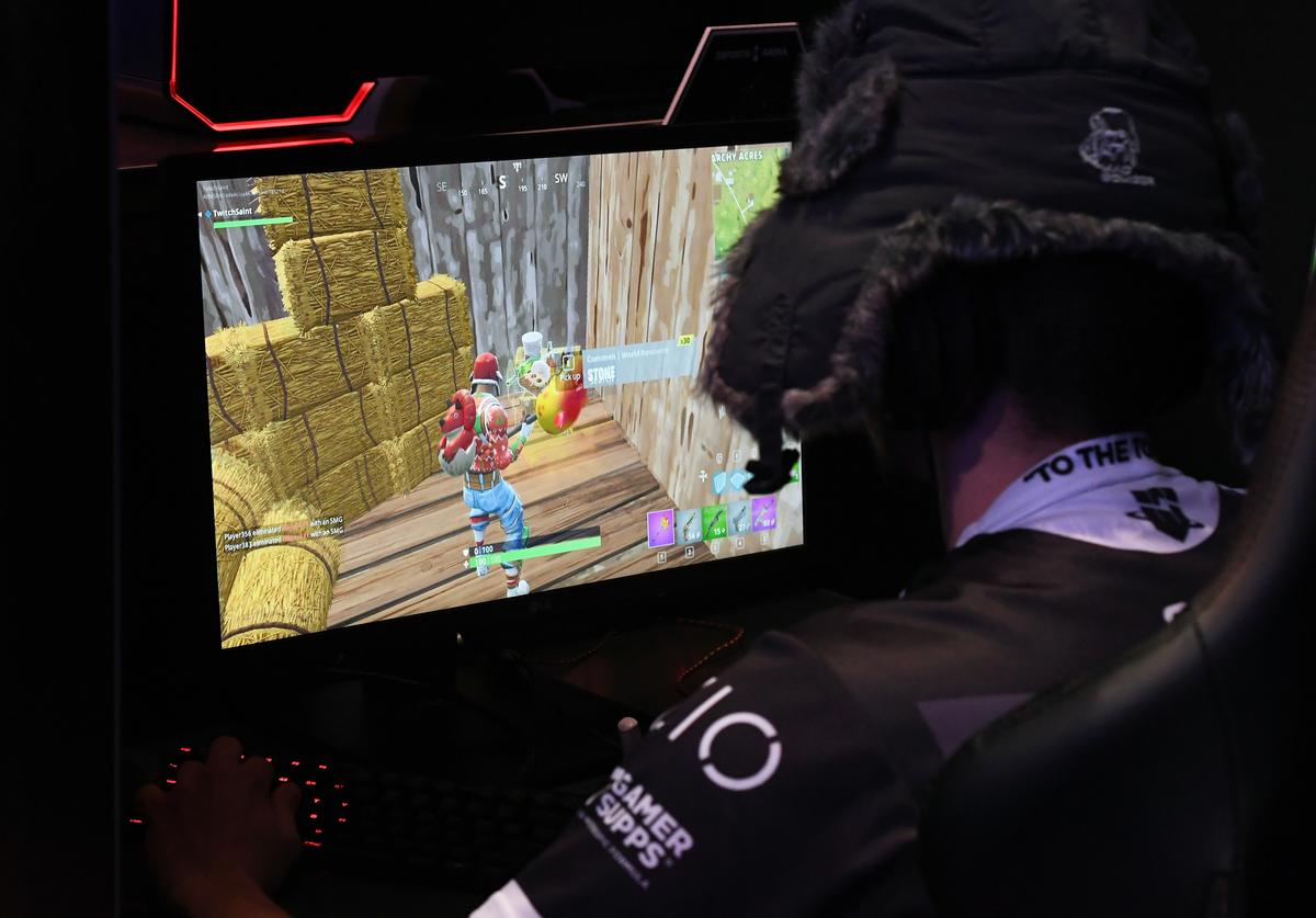 A gamer plays 'Fortnite' against Twitch streamer and professional gamer Tyler 'Ninja' Blevins during Ninja Vegas '18 at Esports Arena Las Vegas at Luxor Hotel and Casino on April 21, 2018 in Las Vegas, Nevada