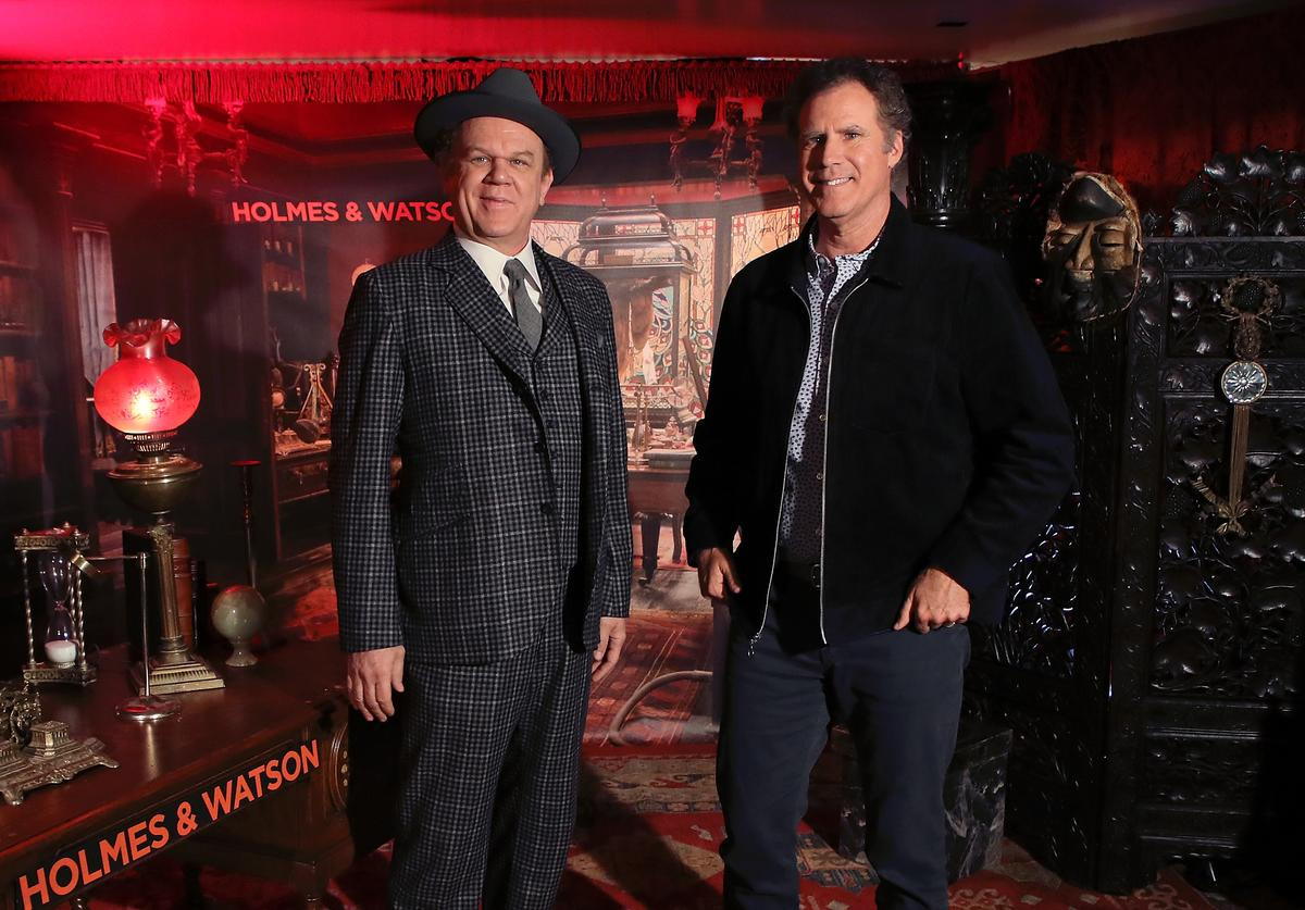 John C. Reilly (L) and Will Ferrell attend the 'Holmes & Watson' photo call at The London West Hollywood on December 14, 2018 in West Hollywood, California.