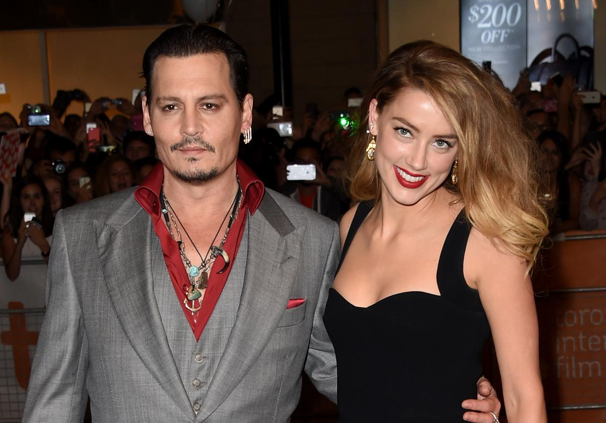 Johnny Depp (L) and Actress Amber Heard attend the 'Black Mass' premiere during the 2015 Toronto International Film Festival at The Elgin on September 14, 2015 in Toronto, Canada