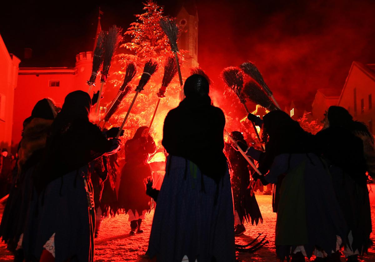 : Locals dressed as 'Perchten', a traditional demonic creature in German and Austrian Alpine folklore, parade through the town center during the annual 'Rauhnacht' gathering on January 5, 2017 in Waldkirchen, Germany.