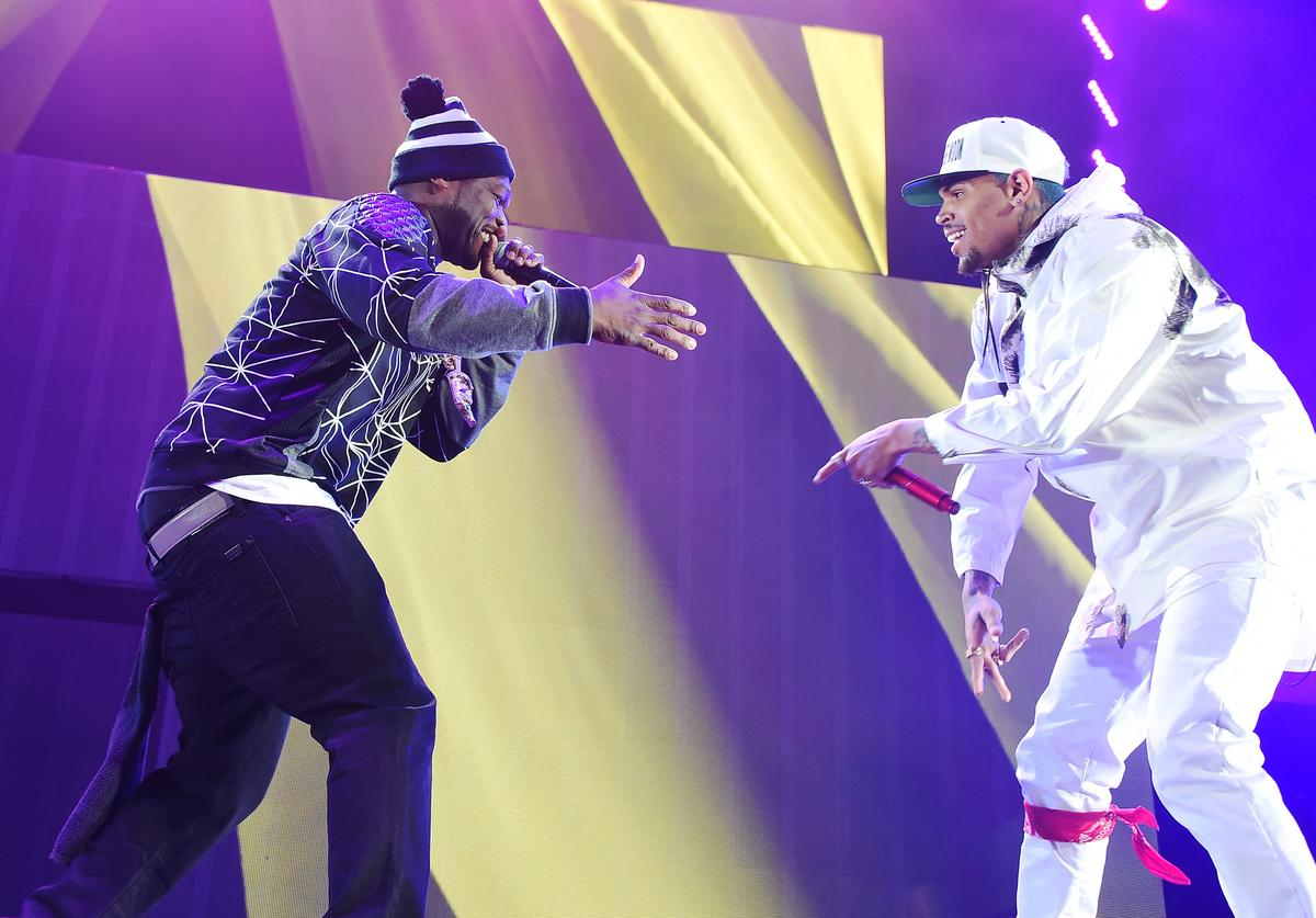 50 Cent (L) and Chris Brown perform onstage during the 'Between The Sheets' tour at Barclays Center of Brooklyn on February 16, 2015 in New York City