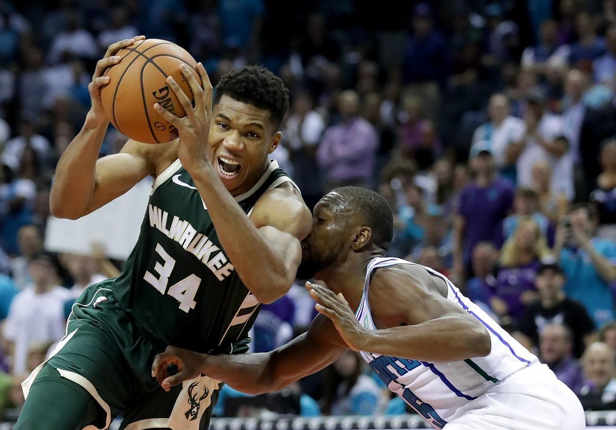 Giannis Antetokounmpo #34 of the Milwaukee Bucks drives to the basket against Kemba Walker #15 of the Charlotte Hornets during their game at Spectrum Center on October 17, 2018 in Charlotte, North Carolina.