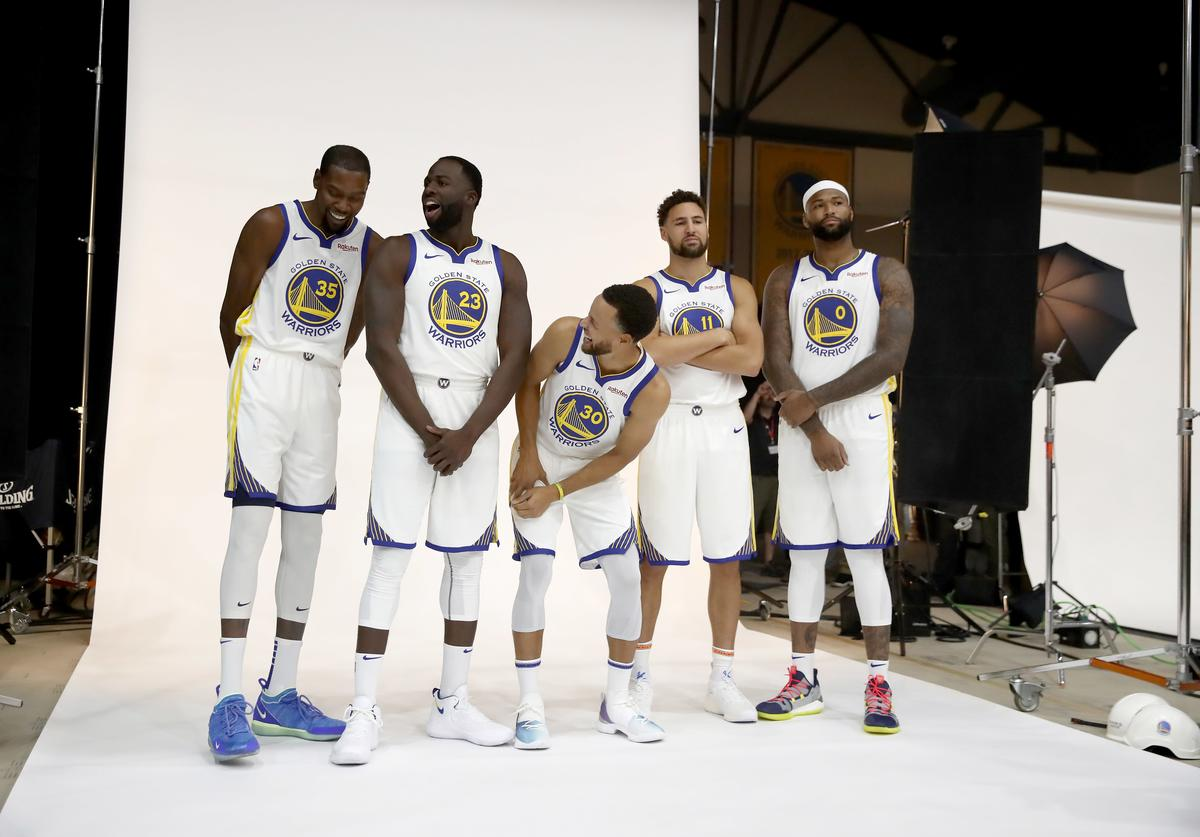 Kevin Durant #35, Draymond Green #23, Stephen Curry #30, Klay Thompson #11, and DeMarcus Cousins #0 of the Golden State Warriors pose for a group picture during the Golden State Warriors media day on September 24, 2018 in Oakland, California.