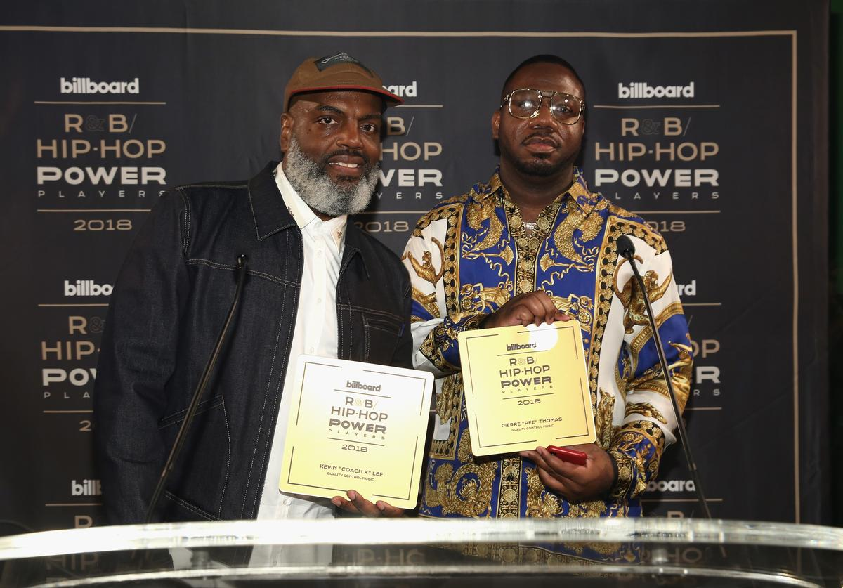 "Kevin Coach K Lee (L) and Quality Control's Pierre ""Pee"" Thomas speak onstage at the Billboard 2018 R&B Hip-Hop Power Players event at Legacy Records on September 27, 2018 in New York City."