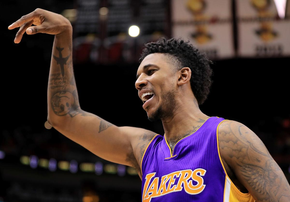 Nick Young #0 of the Los Angeles Lakers reacts to a play during a game against the Miami Heat at American Airlines Arena on December 22, 2016 in Miami, Florida.