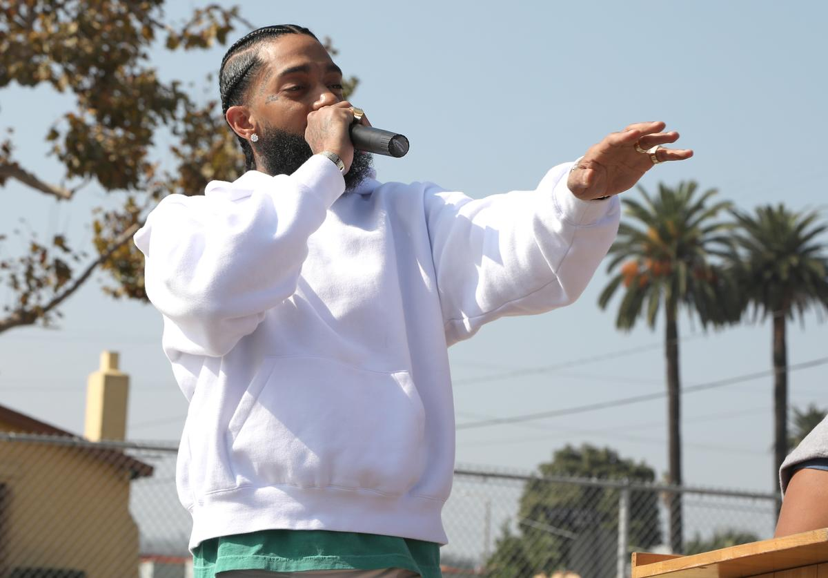 Nipsey Hussle speaks to kids at the Nipsey Hussle x PUMA Hoops Basketball Court Refurbishment Reveal Event on October 22, 2018 in Los Angeles, California