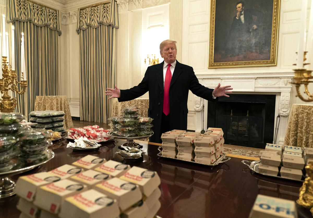 U.S President Donald Trump presents fast food to be served to the Clemson Tigers football team to celebrate their Championship at the White House on January 14, 2019 in Washington, DC.