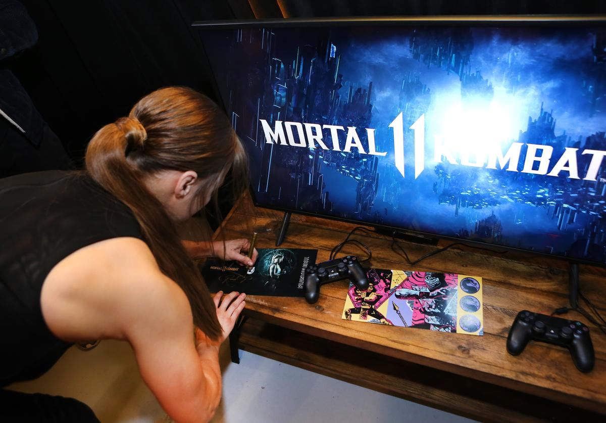 Ronda Rousey signs autographs at Mortal Kombat 11: The Reveal on January 17, 2019 in Los Angeles, California.