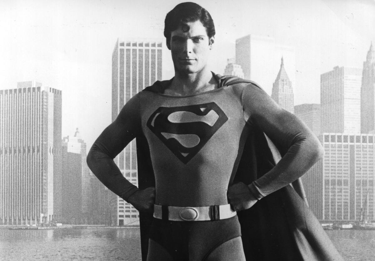 24-year-old American film actor Christopher Reeve stands before the Manhattan skyline dressed as the comic-book hero of the film 'Superman'.