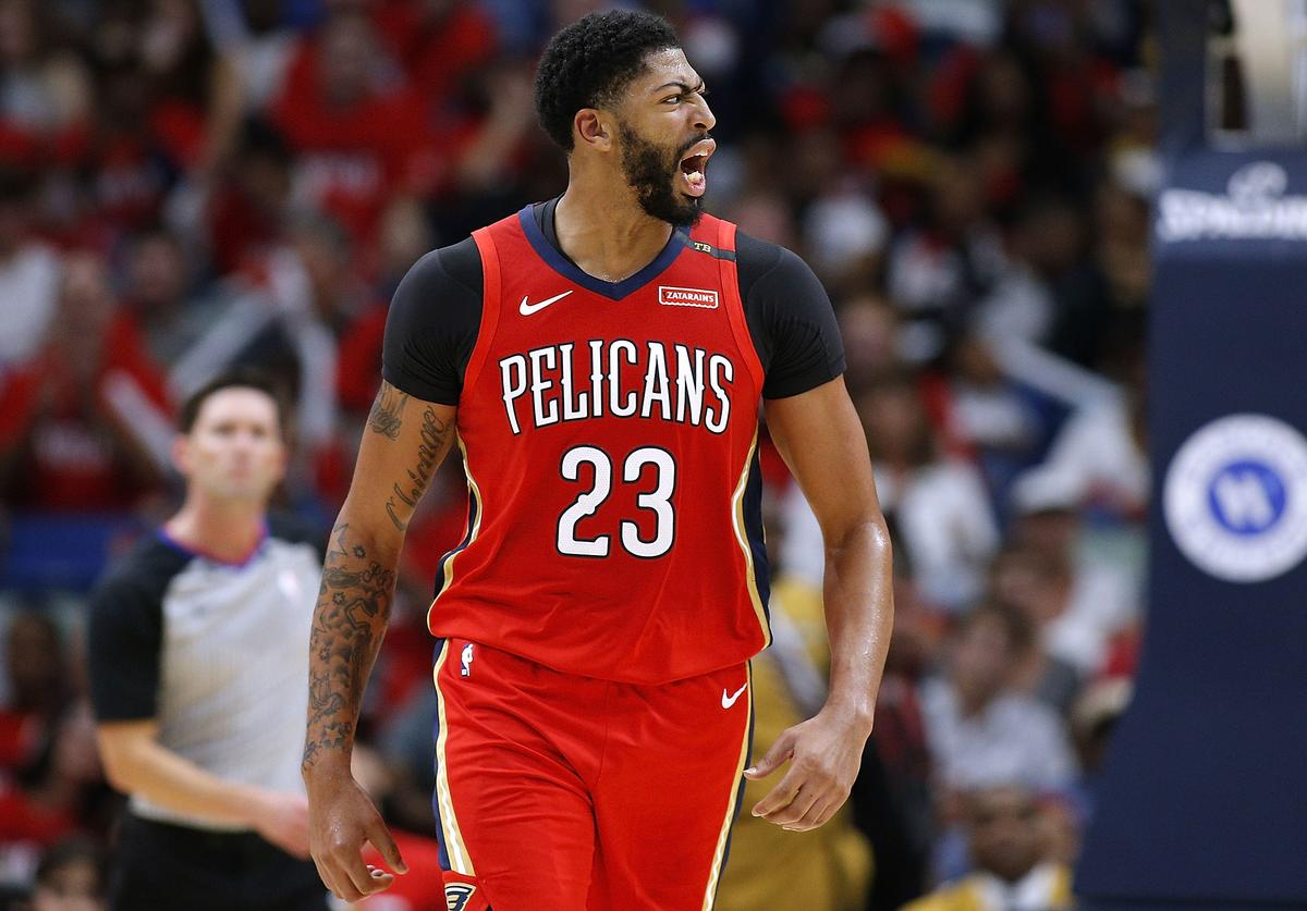 Anthony Davis #23 of the New Orleans Pelicans reacts during the first half against the Sacramento Kings at the Smoothie King Center on October 19, 2018 in New Orleans, Louisiana. NOTE TO USER: User expressly acknowledges and agrees that, by downloading and or using this photograph, User is consenting to the terms and conditions of the Getty Images License Agreement.