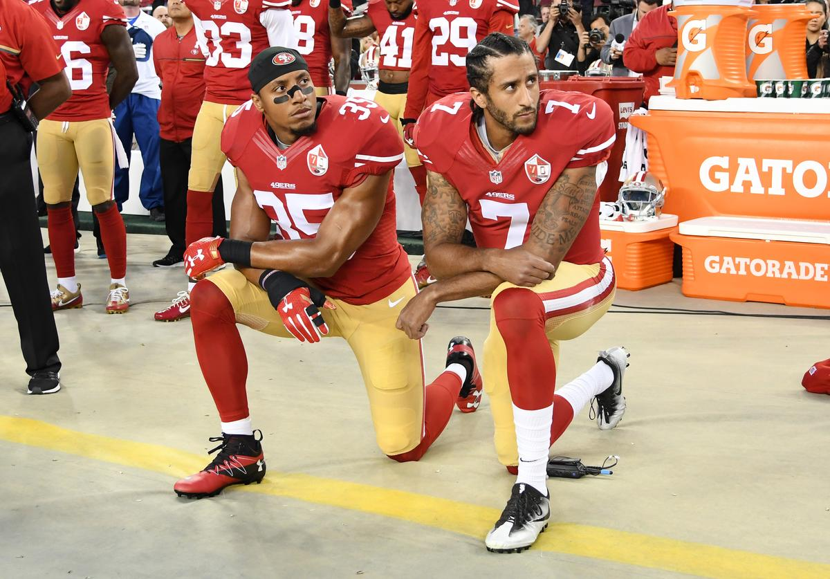 : Colin Kaepernick #7 and Eric Reid #35 of the San Francisco 49ers kneel in protest during the national anthem prior to playing the Los Angeles Rams in their NFL game at Levi's Stadium on September 12, 2016 in Santa Clara, California.