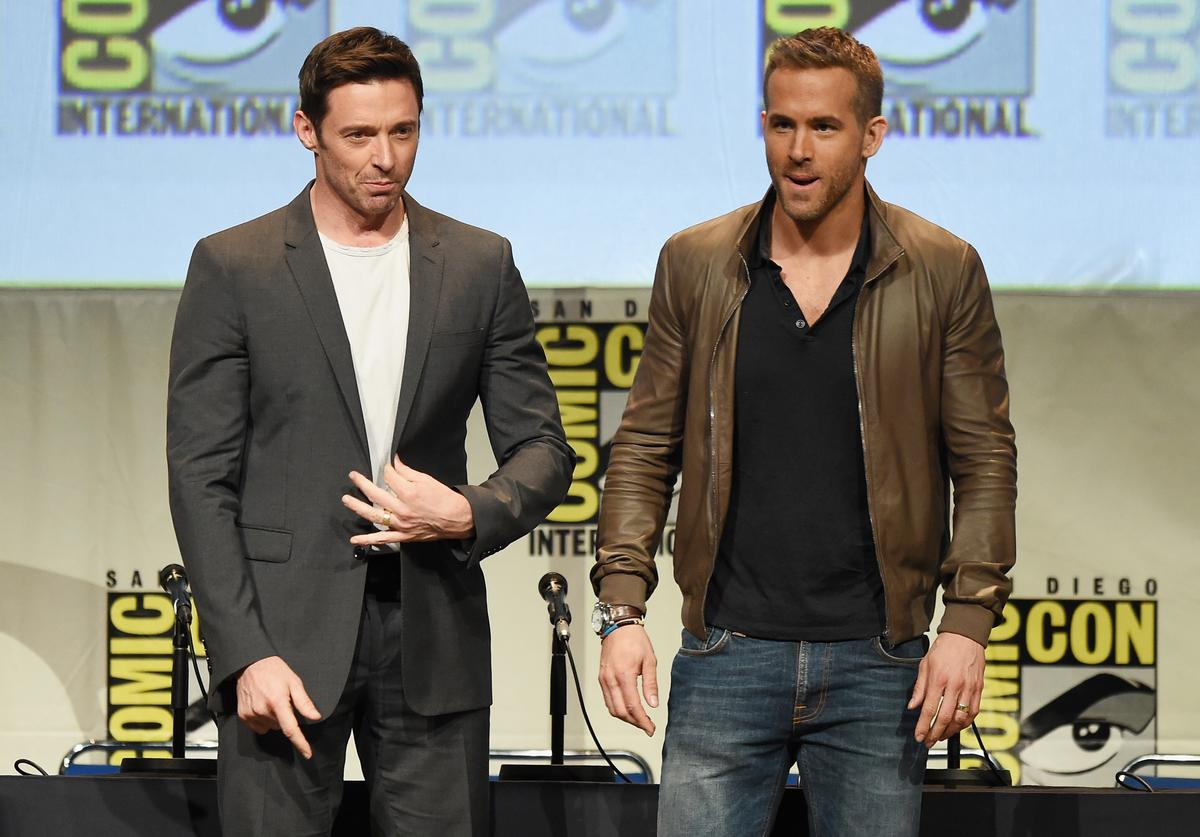 Hugh Jackman (L) and Ryan Reynolds appear onstage at the 20th Century FOX panel during Comic-Con International 2015 at the San Diego Convention Center on July 11, 2015 in San Diego, California
