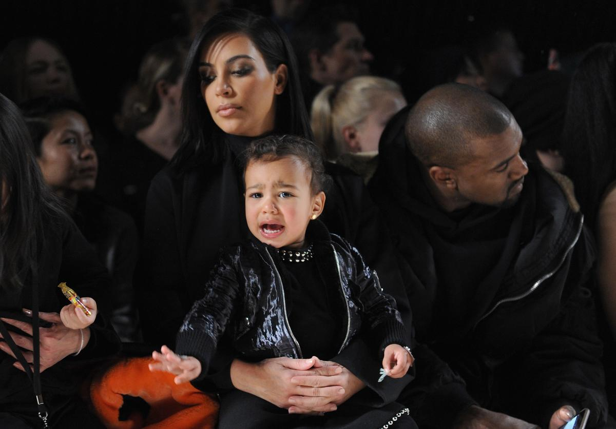 Kim Kardashian, North West and Kanye West attend the Alexander Wang Fashion Show during Mercedes-Benz Fashion Week Fall 2015 at Pier 94 on February 14, 2015 in New York City