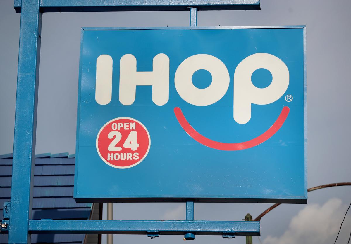 An IHOP restaurant serves customers on August 10, 2017 in Chicago, Illinois. DineEquity, the parent company of Applebee's and IHOP, plans to close up to 160 restaurants in the first quarter of 2018. The announcement helped the stock climb more than 4 percent today. (