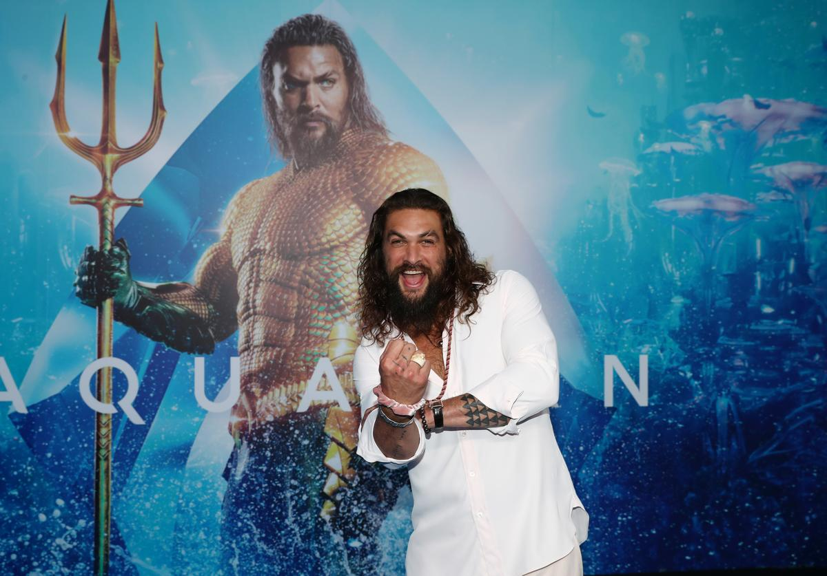 Jason Momoa poses at the Australian premiere of Aquaman on December 18, 2018 in Gold Coast, Australia