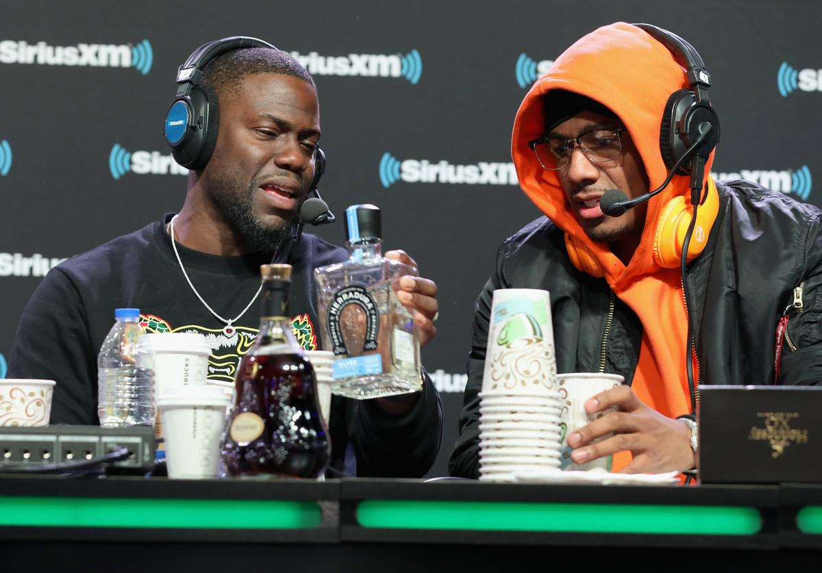 Kevin Hart and Nick Cannon attend SiriusXM at Super Bowl LIII Radio Row on February 01, 2019 in Atlanta, Georgia