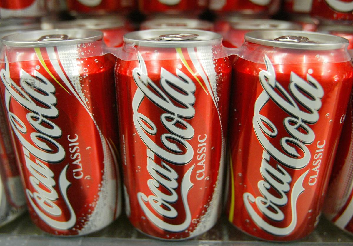 Cans of Coca-Cola are seen on the shelf at Tower Market January 16, 2004 in San Francisco, California