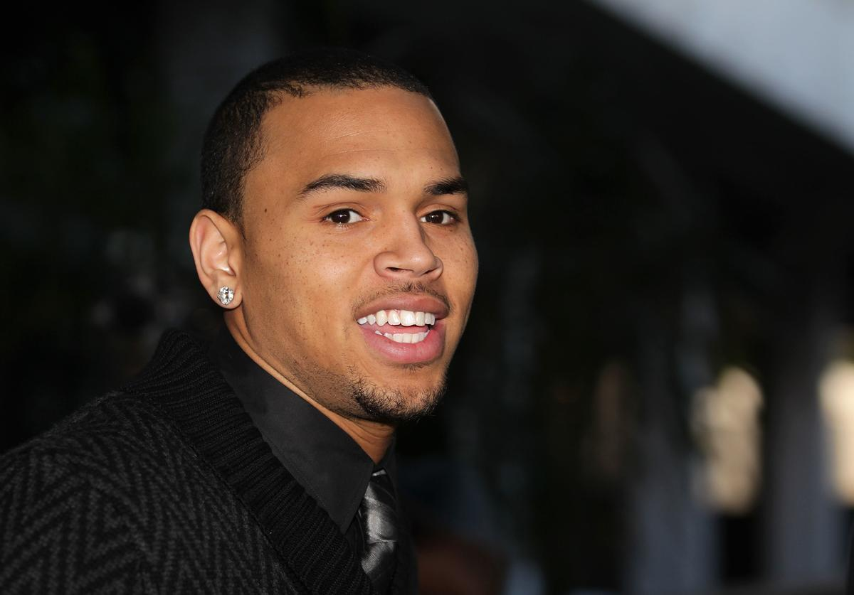 Chris Brown leaves the Los Angeles courthouse after a probation progress hearing on January 28, 2011 in Los Angeles, California