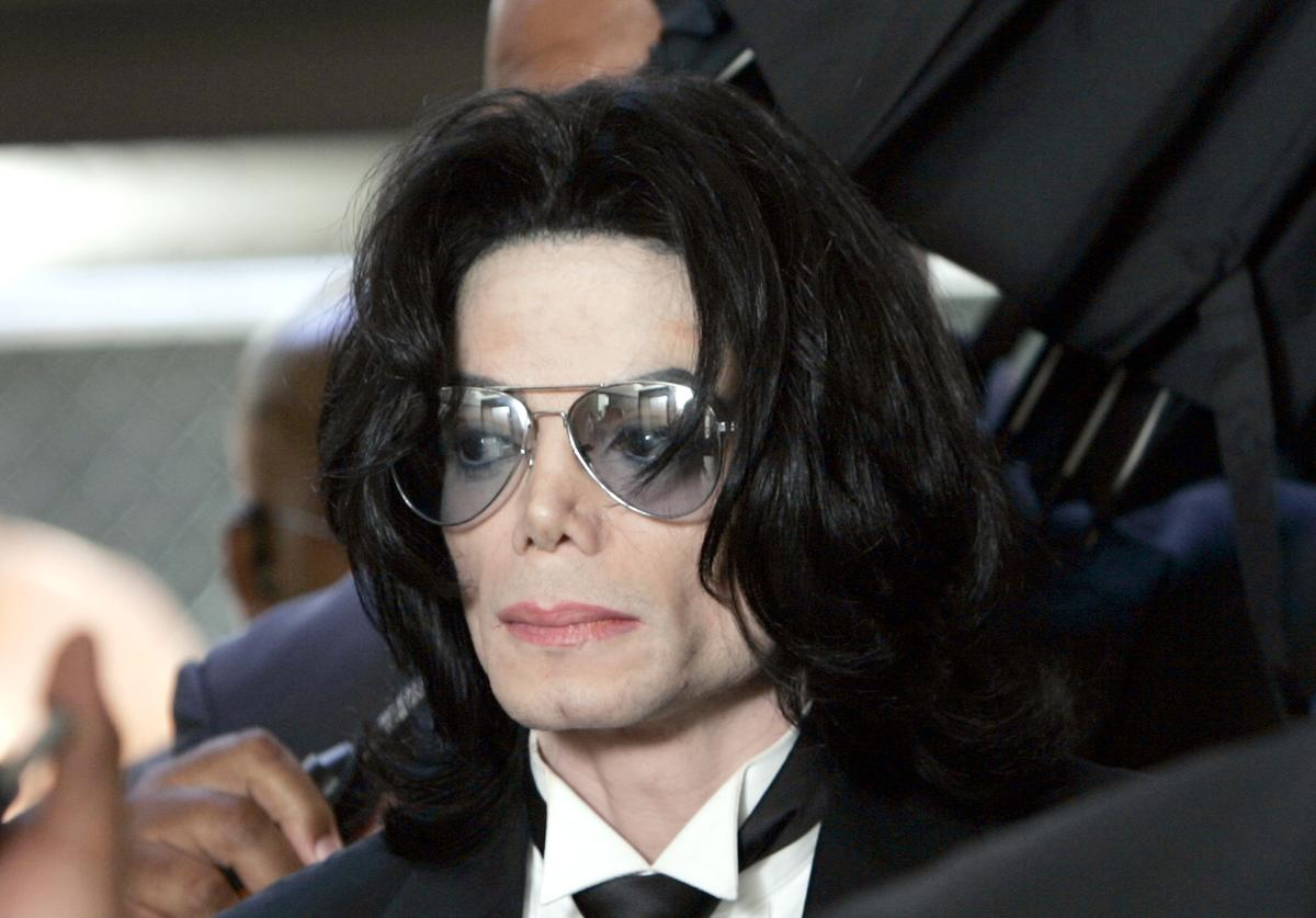 Michael Jackson prepares to enter the Santa Barbara County Superior Court to hear the verdict read in his child molestation case June 13, 2005 in Santa Maria, California. After seven days of deliberation the jury has reached a not guilty verdict on all 10 counts in the trial against Michael Jackson. Jackson was charged in a 10-count indictment with molesting a boy, plying him with liquor and conspiring to commit child abduction, false imprisonment and extortion. He pleaded innocent.