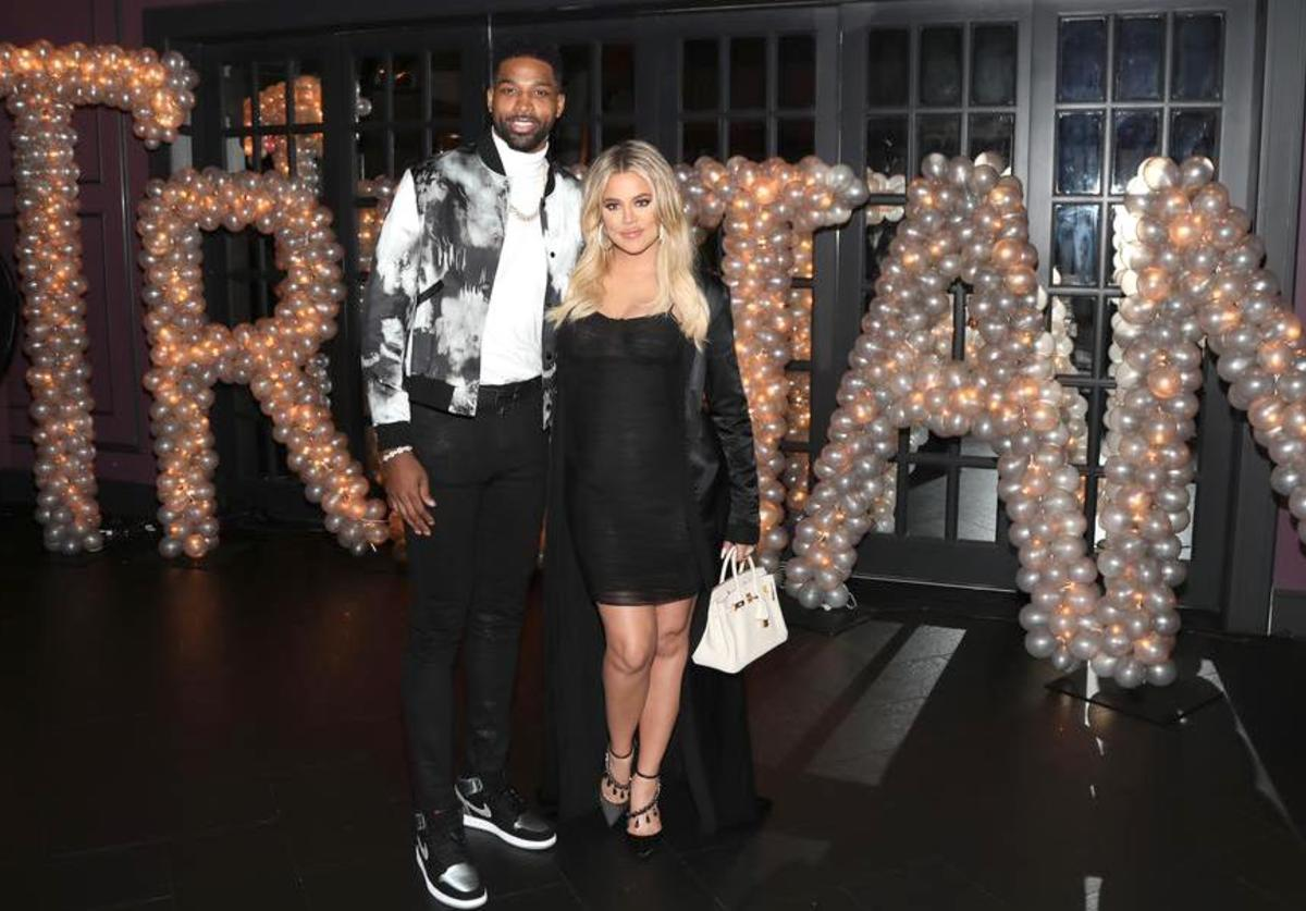 Tristan Thompson and Khloe Kardashian pose for a photo as Remy Martin celebrates Tristan Thompson's Birthday at Beauty & Essex on March 10, 2018 in Los Angeles, California