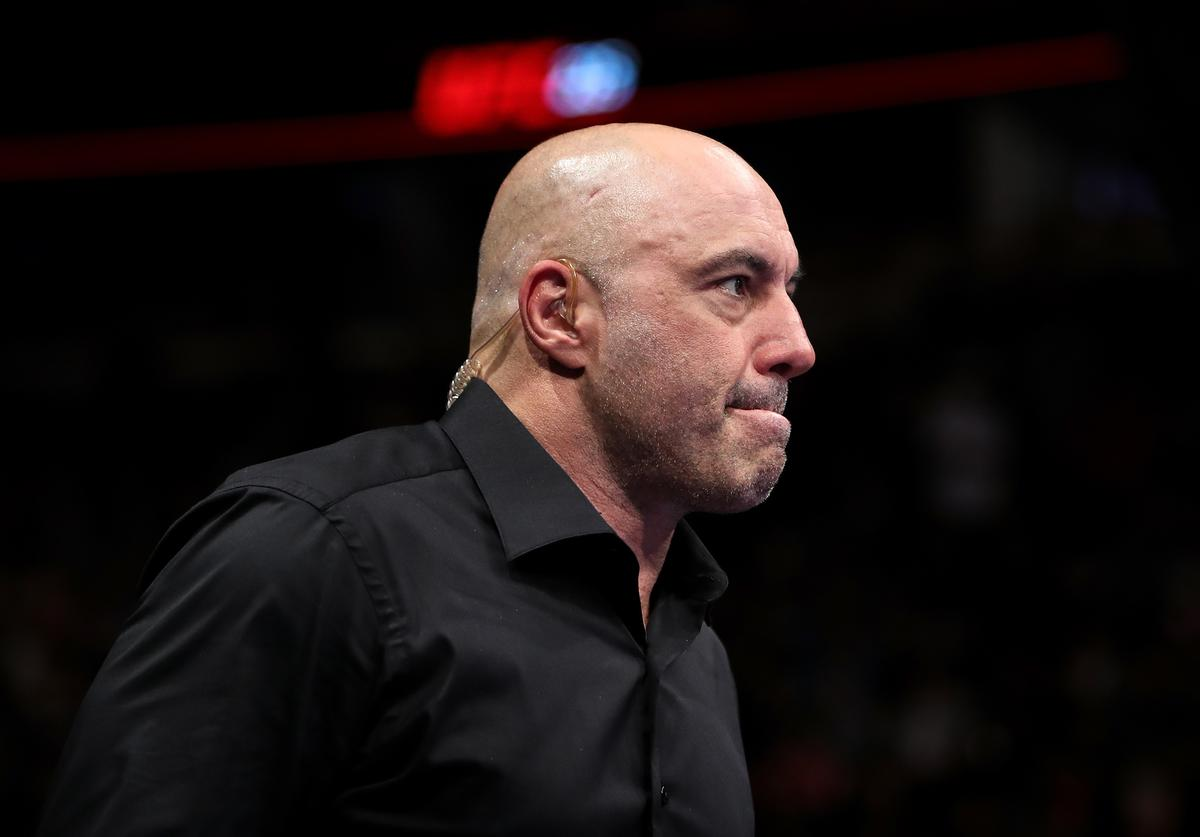Joe Rogan enters the octagon during the UFC 225: Whittaker v Romero 2 event at the United Center on June 9, 2018 in Chicago, Illinois