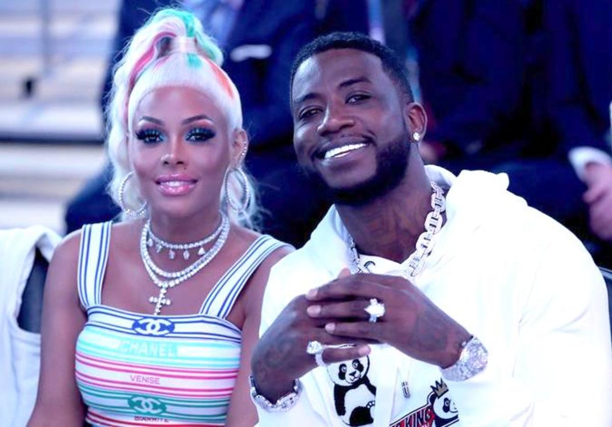 Gucci Mane (R) sits with his wife Keyshia Ka'Oir (L) before Team LeBron takes on Team Giannis during the NBA All-Star game as part of the 2019 NBA All-Star Weekend at Spectrum Center on February 17, 2019 in Charlotte, North Carolina