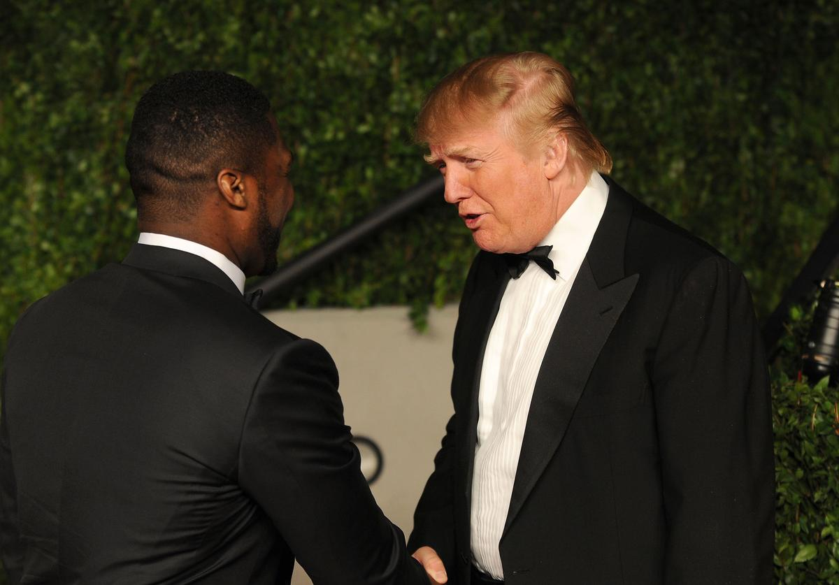 50 Cent and Donald Trump arrive at the Vanity Fair Oscar party hosted by Graydon Carter held at Sunset Tower on February 27, 2011 in West Hollywood, California