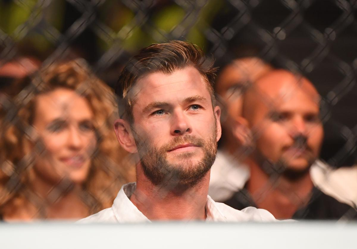 Chris Hemsworth sits ringside during UFC234 at Rod Laver Arena on February 10, 2019 in Melbourne, Australia