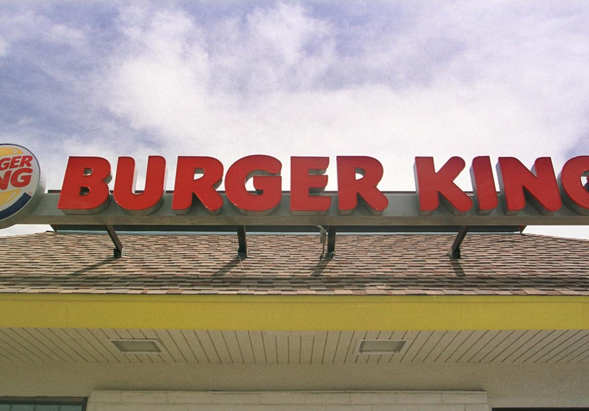 Burger King logo and sign sit atop a Burger King restaurant June 12, 2001 in Federal Heights, Colorado