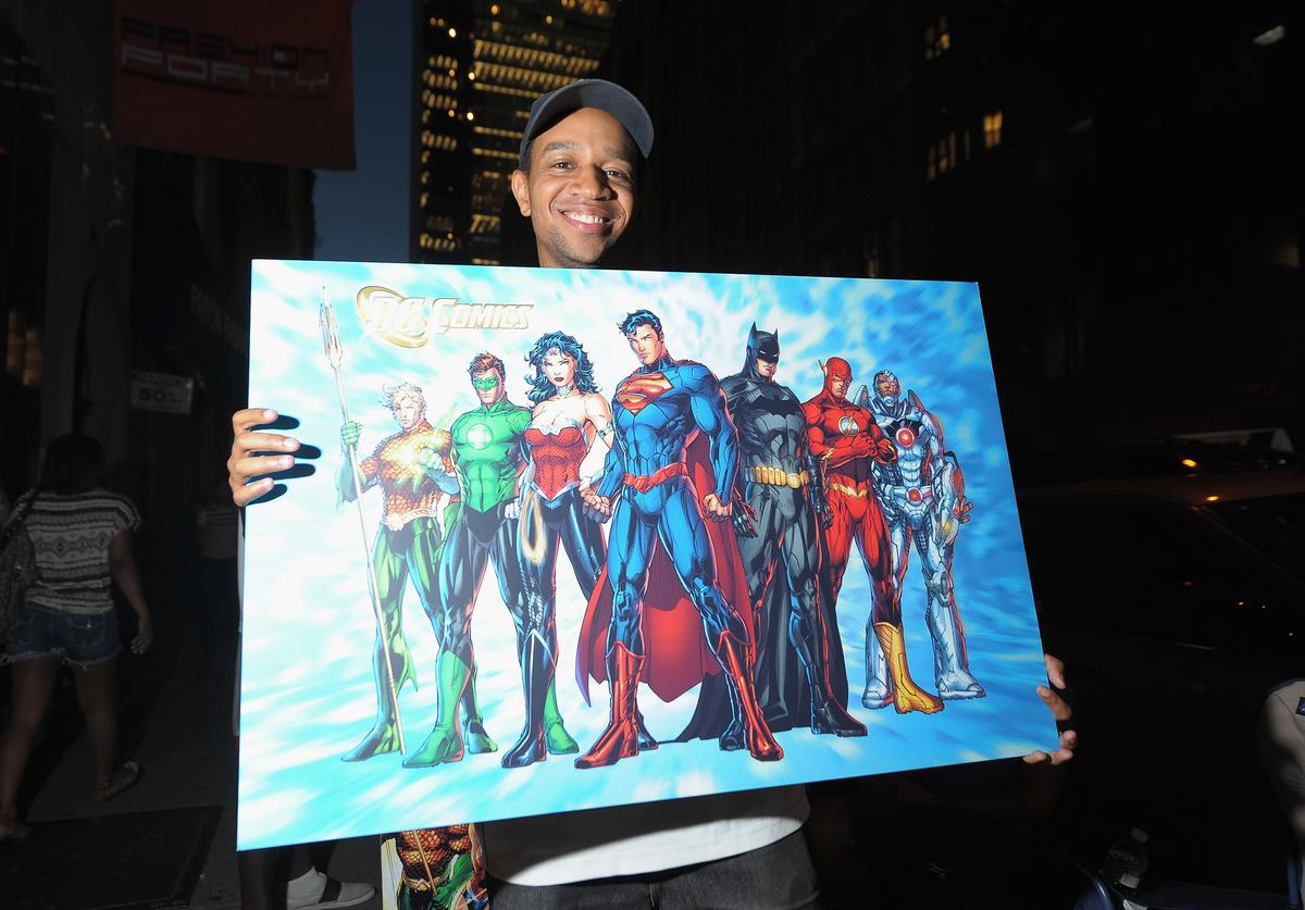 Excited Fans at DC Comics' Midnight Madness Event Celebrating the release of New No. 1 issue of 'Justice League' at Mid Town Comics on August 30, 2011 in New York City