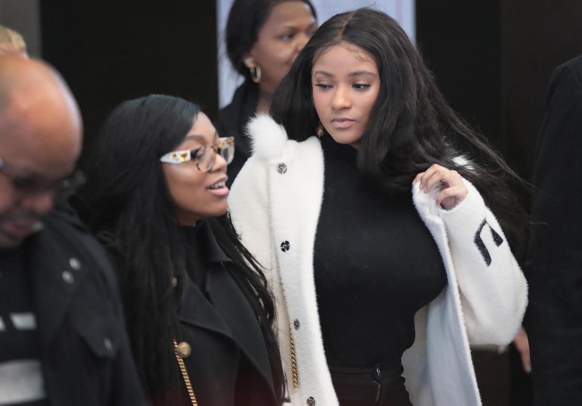 Jocelyn Savage (R) and Azriel Clary arrive for a bond hearing for R&B singer R. Kelly at the Leighton Criminal Court Building on February 23, 2019 in Chicago, Illinois