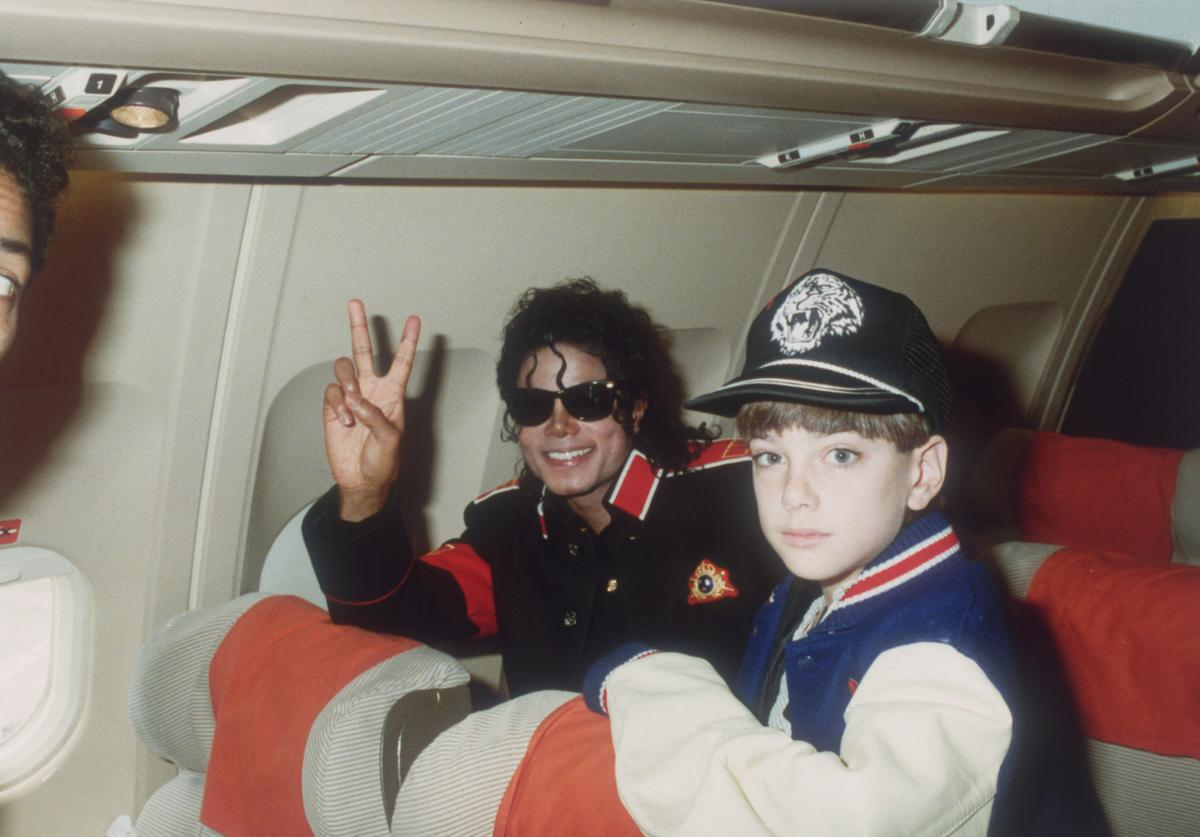 Michael Jackson with 10 year old Jimmy Safechuck on the tour plane on 11th of July 1988