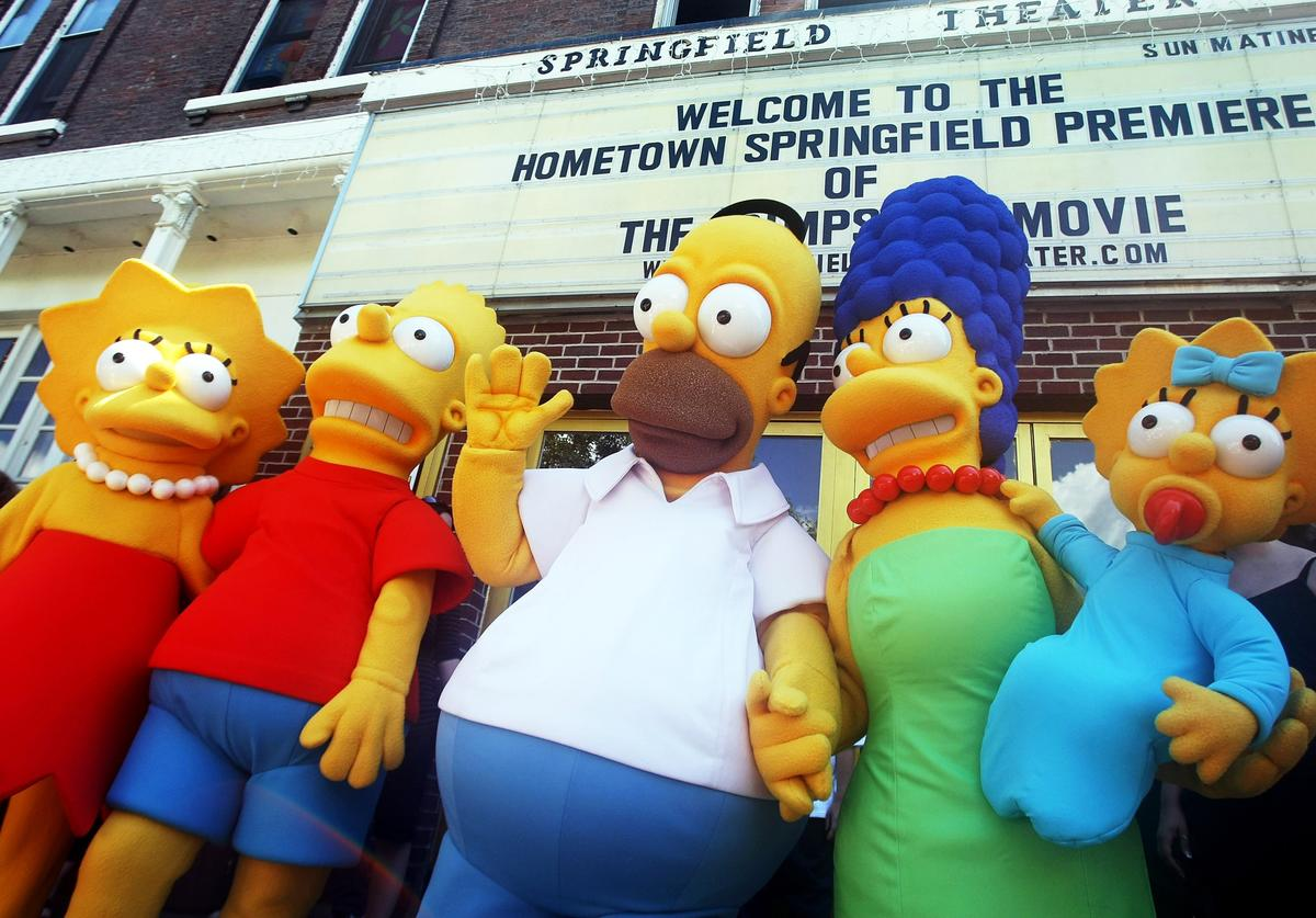Characters from the film pose for photos during the hometown premiere of 'The Simpsons Movie' on July 21, 2007 in Springfield, Vermont.