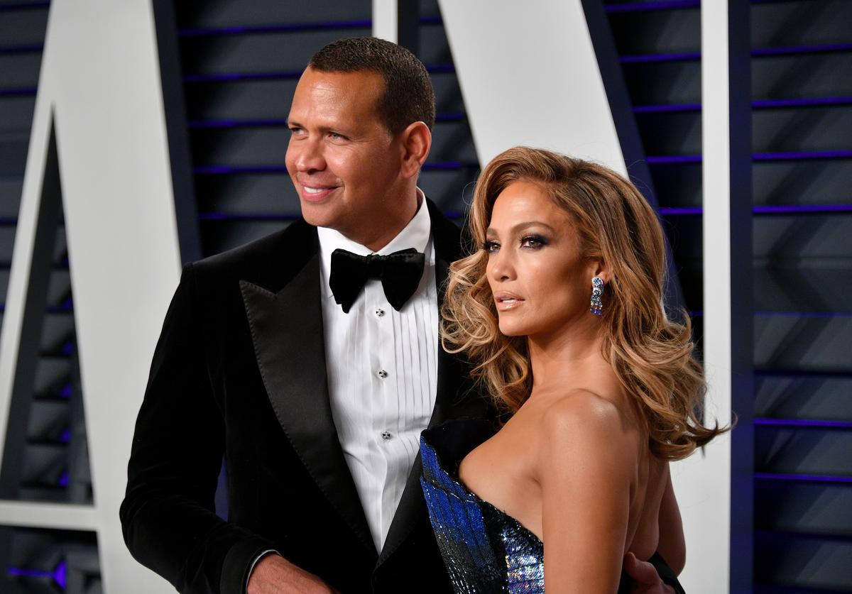 Alex Rodriguez (L) and Jennifer Lopez attend the 2019 Vanity Fair Oscar Party hosted by Radhika Jones at Wallis Annenberg Center for the Performing Arts on February 24, 2019 in Beverly Hills, California