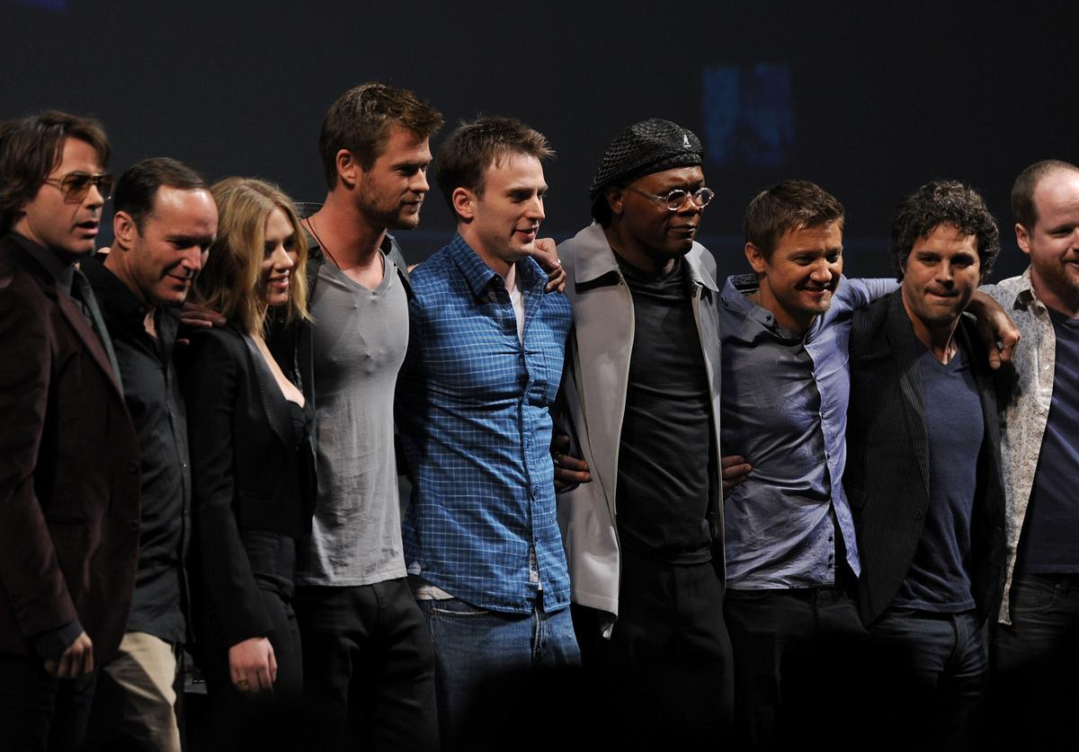 Actors Robert Downey Jr., Clark Gregg, Scarlett Johansson, Chris Hemsworth, Chris Evans, Samuel L. Jackson, Jeremy Renner, Mark Ruffalo and writer/Director Joss Whedon pose onstage at the Marvel Studios' 'Captain America: The First Avenger' panel discussion during Comic-Con 2010 at San Diego Convention Center on July 24, 2010 in San Diego, California.