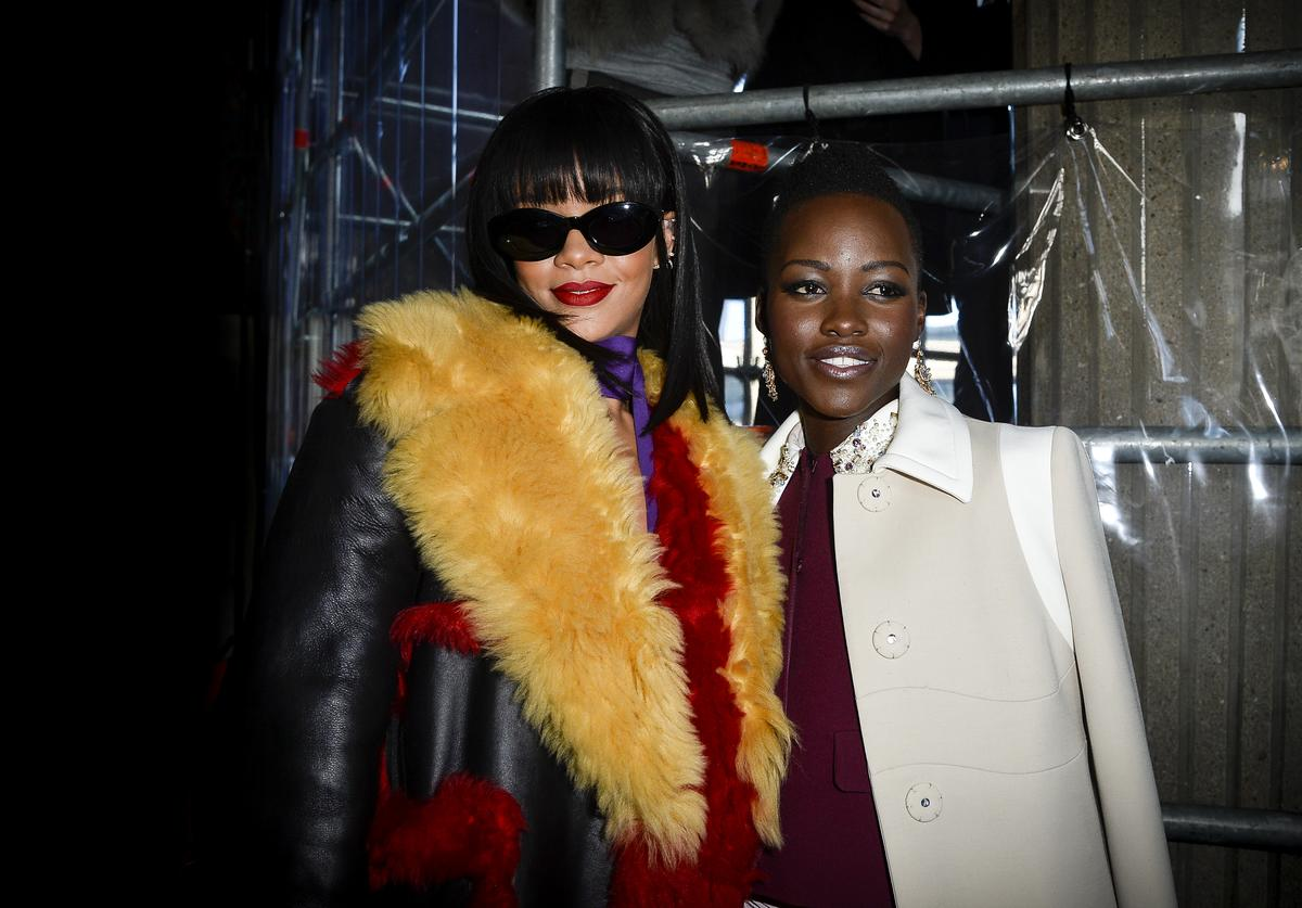 Lupita Nyong'o and singer Rihanna attend the Miu Miu show as part of the Paris Fashion Week Womenswear Fall/Winter 2014-2015 on March 5, 2014 in Paris, France