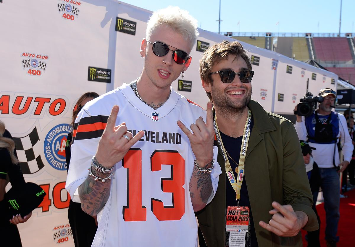 Machine Gun Kelly and Douglas Booth attend the driver's meeting prior to the Monster Energy NASCAR Cup Series Auto Club 400 at Auto Club Speedway on March 17, 2019 in Fontana, California
