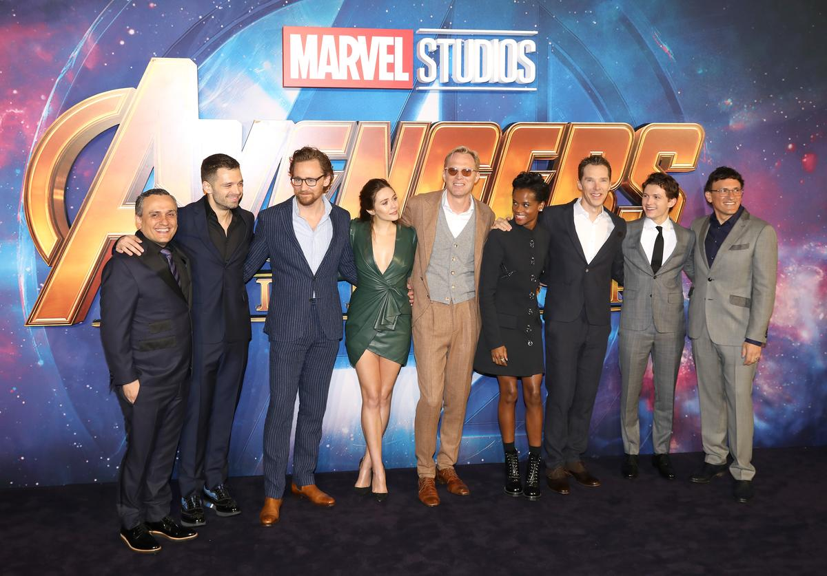Joe Russo, actors Sebastian Stan, Tom Hiddleston, Elizabeth Olsen, Paul Bettany, Letitia Wright, Benedict Cumberbatch, Tom Holland and director Anthony Russo attend the UK Fan Event for 'Avengers Infinity War' at Television Studios White City on April 8, 2018 in London, England