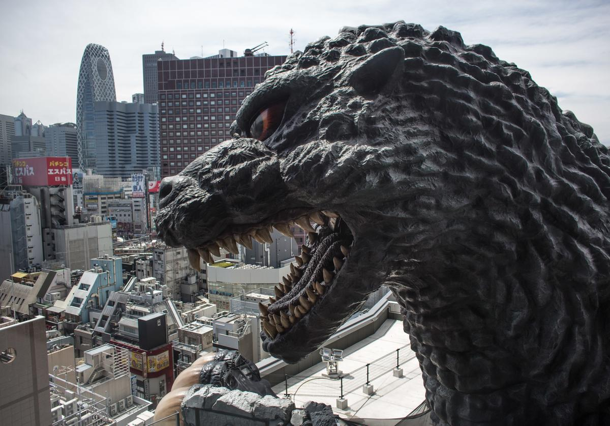 A 12 meter tall Godzilla replica head is seen on the 8th floor terrace of the Hotel Gracery Shinjuku on April 15, 2015 in Tokyo, Japan.