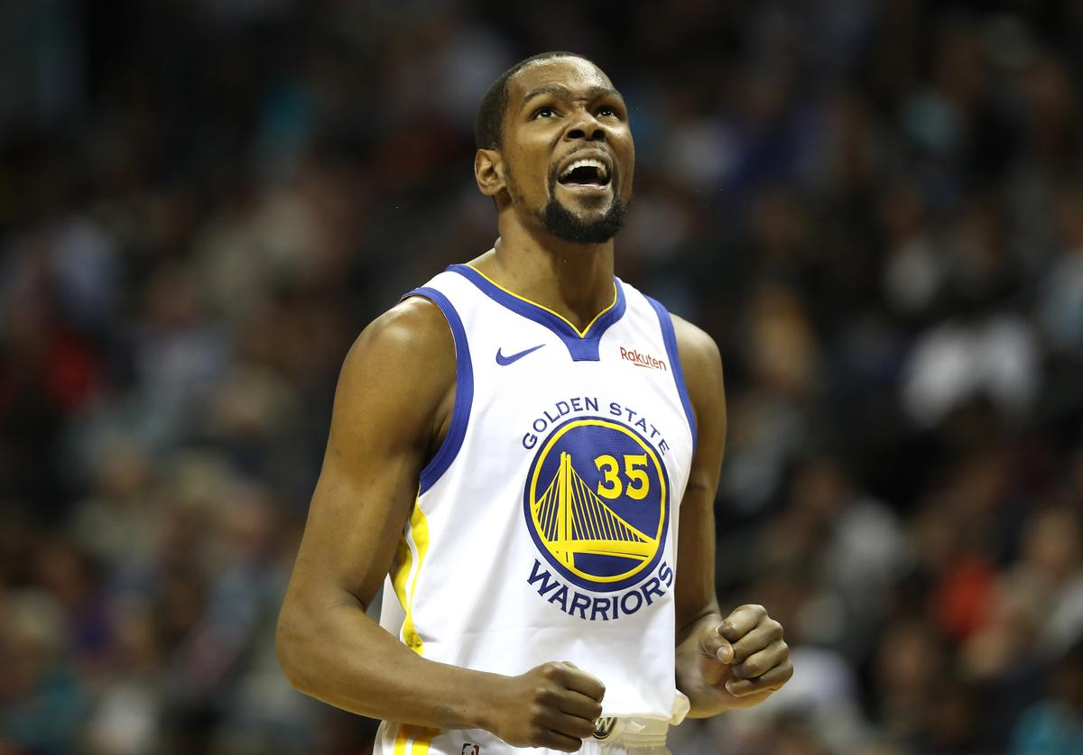 Kevin Durant #35 of the Golden State Warriors reacts after a play against the Charlotte Hornets during their game at Spectrum Center on February 25, 2019 in Charlotte, North Carolina. NOTE TO USER: User expressly acknowledges and agrees that, by downloading and or using this photograph, User is consenting to the terms and conditions of the Getty Images License Agreement.