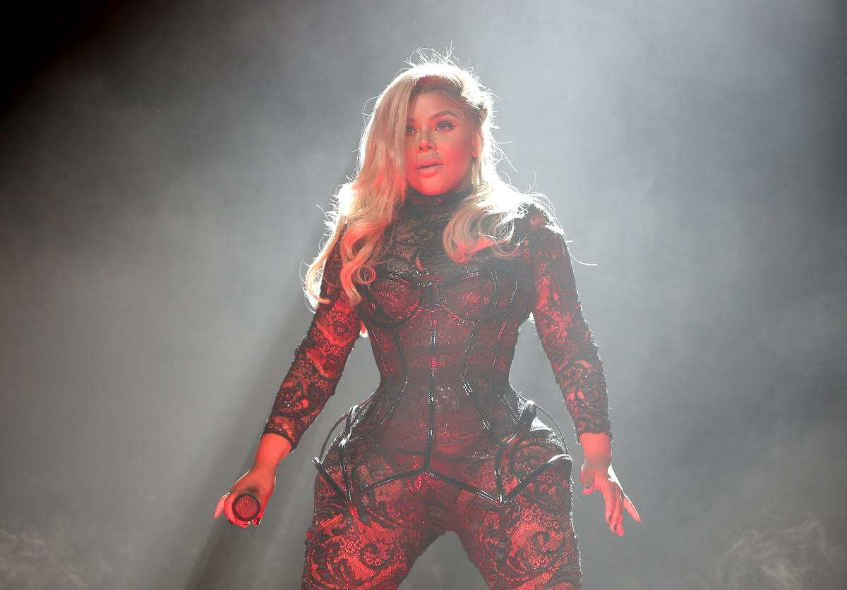 Lil' Kim performs on stage during the Live Nation presents Bad Boy Family Reunion Tour sponsored by Ciroc Vodka, AQUAhydrate, DeLeon Tequila, Sean John and Macy's opening night at United Center on September 1, 2016 in Chicago, Illinois