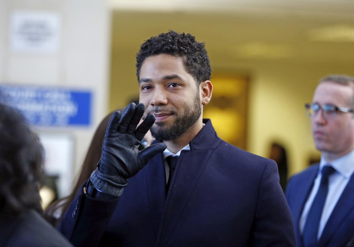 Actor Jussie Smollett waves as he follows his attorney to the microphones after his court appearance at Leighton Courthouse on March 26, 2019 in Chicago, Illinois. This morning in court it was announced that all charges were dropped against the actor.