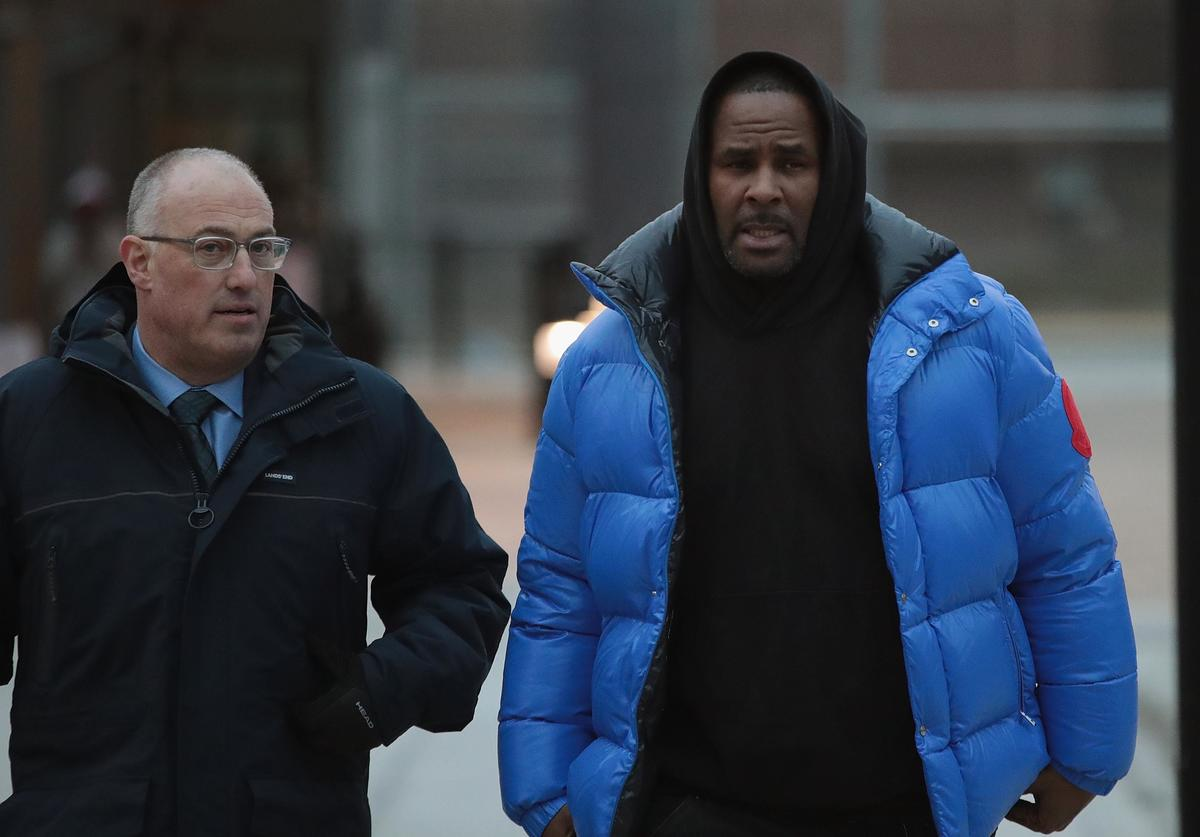 &B singer R. Kelly (R) and his attorney Steve Greenberg leave Cook County jail after Kelly posted $100 thousand bond on February 25, 2019 in Chicago, Illinois. Kelly was being held after turning himself in to face ten counts of aggravated sexual abuse.