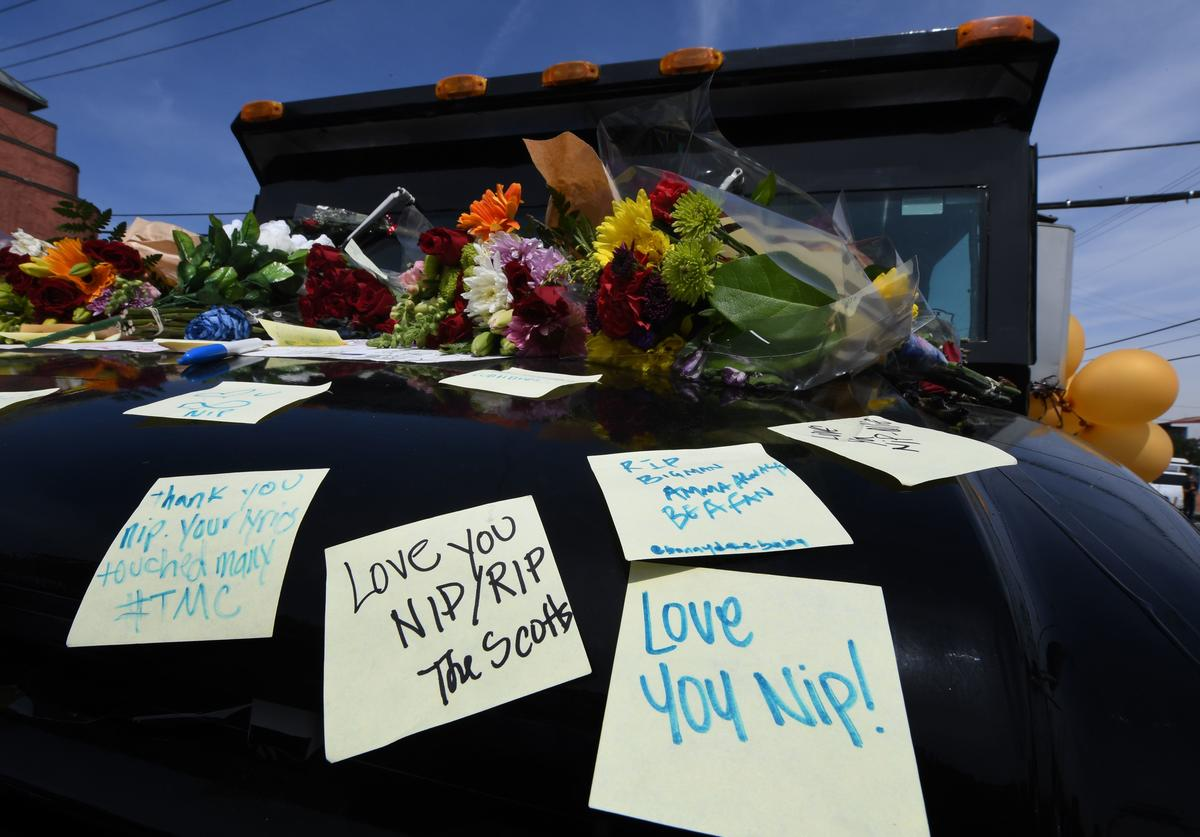 Fans leave messages on his armored vehicle parked outside The Marathon clothing store owned by Grammy-nominated rapper Nipsey Hussle where he was fatally shot along with 2 other wounded in Los Angeles, California on April 1, 2019