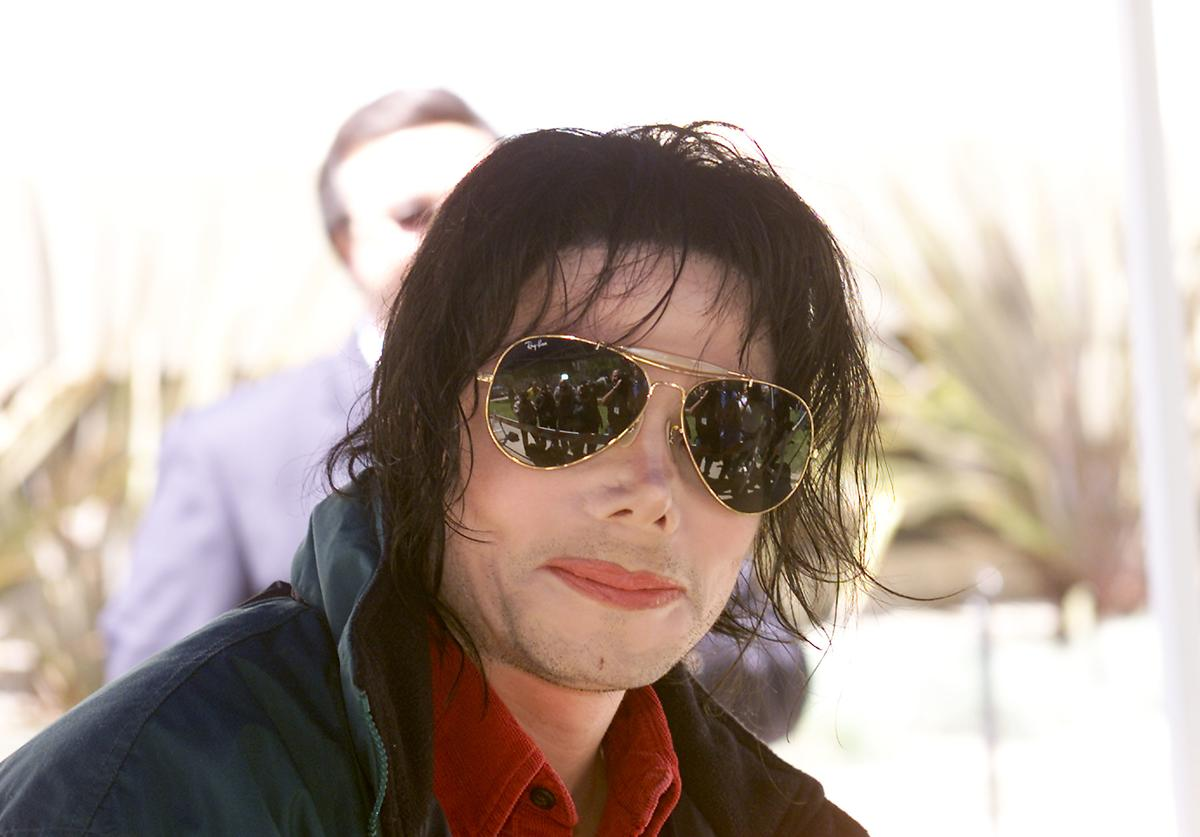 Michael Jackson arrives at the Pasadena Civic Auditorium in Pasadena, Ca. to tape his performance for Dick Clark's 'American Bandstand's 50th...A Celebration', Saturday, April 20, 2002.